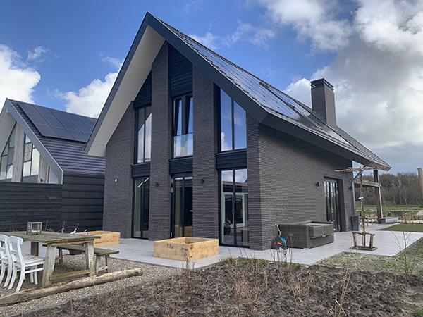 GROEP NEGEN | moderne schuurwoning in baksteen met houten spant